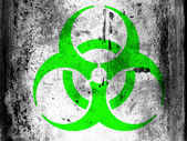 Biohazard sign painted on board with grungy dirty stains all over it — Stock Photo