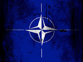 NATO symbol painted on board with grungy dirty stains all over it — Stock Photo