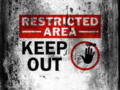 Restricted area sign painted on board with grungy dirty stains all over it — Stock Photo