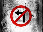 No left turn road sign painted on board with grungy dirty stains all over it — Stock Photo
