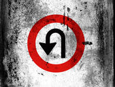 U turn road sign painted on board with grungy dirty stains all over it — Stock Photo