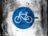 Bicycle road sign painted on board with grungy dirty stains all over it — Stock Photo