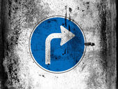 Right turn road sign painted on board with grungy dirty stains all over it — Stock Photo
