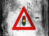 Light signals ahead road sign painted on board with grungy dirty stains all over it — Stock Photo