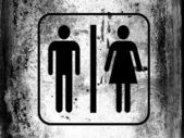 Toilet sign painted on board with grungy dirty stains all over it — Stock Photo