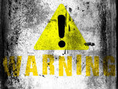 Warning sign painted on board with grungy dirty stains on it — Stock Photo
