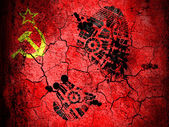 The USSR flag painted on cracked ground with vignette with dirty oil footprint over it — Stock Photo