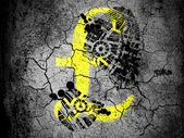 Pound sign painted on cracked ground with vignette with dirty oil footprint over it — Stockfoto