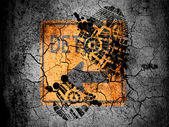Detour road sign painted on cracked ground with vignette with dirty oil footprint over it — Stock Photo