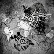 Royalty-Free Stock Photo: World map drawn on cracked ground with vignette with dirty oil footprint over it