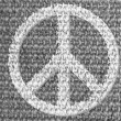 Peace symbol painted on grey fabric — Stock Photo