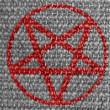 Pentagram symbol painted on grey fabric — Zdjęcie stockowe