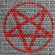 Stock Photo: Pentagram symbol painted on grey fabric