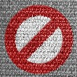 Royalty-Free Stock Photo: Forbidden sign painted on grey fabric