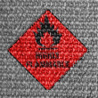 Highly flammable sign drawn on grey fabric — Zdjęcie stockowe