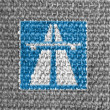 Autobahn road sign painted on grey fabric - Stock Photo