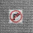 Stock Photo: No right turn road sign painted on grey fabric