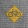 Bicycle road sign painted on grey fabric — Stock Photo #14972541