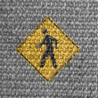 Pedestrian road sign painted on grey fabric — Foto Stock
