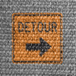 Stock Photo: Detour road sign painted on grey fabric