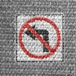 No left turn road sign painted on grey fabric — Stock Photo
