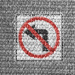 Stock Photo: No left turn road sign painted on grey fabric