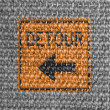 Detour road sign painted on grey fabric — Stock Photo
