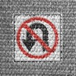 No U turn road sign painted on grey fabric — Stock Photo