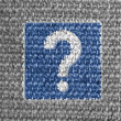 Question road sign painted on grey fabric — Stock Photo