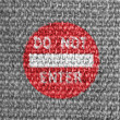 Stock Photo: Do not enter road sign painted on grey fabric