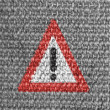 Warning road sign painted on grey fabric — Stock Photo