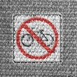 No bicycle road sign painted on grey fabric — Stock Photo #14972771