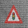 Light signals ahead road sign painted on grey fabric - Stock Photo