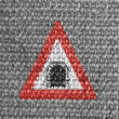 Tunnel ahead road sign painted on grey fabric - Stock Photo