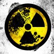 Nuclear radiation symbol painted on whiteboard with dirty footprint on it — Stock Photo