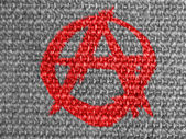 Anarchy symbol painted on grey fabric — Stock Photo
