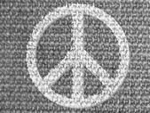 Peace symbol painted on grey fabric — Stock Photo