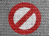 Forbidden sign painted on grey fabric — Stock Photo