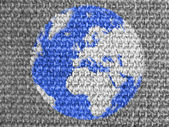 Globe painted on grey fabric — Stock Photo