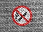 No smoking sign drawn at grey fabric — Stock Photo