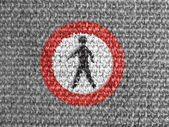 No pedestrian road sign painted on grey fabric — Stock Photo