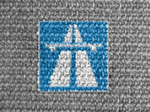 Autobahn road sign painted on grey fabric — Stock Photo