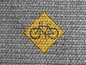 Bicycle road sign painted on grey fabric — Stock Photo