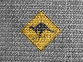 Kangaroo road sign painted on grey fabric — Stock Photo