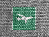 Plane road sign painted on grey fabric — ストック写真