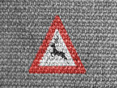 Deer road sign painted on grey fabric — Stok fotoğraf