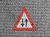Two-way traffic straight ahead road sign painted on grey fabric — Stock Photo