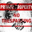 Stock Photo: No trespassing sign painted on whiteboard with dirty footprint on it