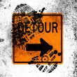 Detour road sign painted on whiteboard with dirty footprint on it - Stock Photo