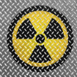 Nuclear radiation symbol painted on metal floor — Stock Photo #15008747